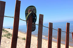 Lost sandal on Lake Michigan snow fence